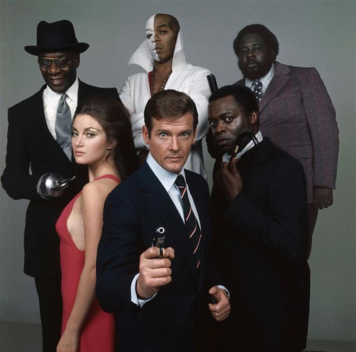 Roger Moore as James Bond with Cast 1973